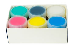 Set of acrylic paints in cardboard box Royalty Free Stock Images