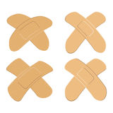 Set of Adhesive, flexible, fabric plaster . Medical bandage in different shape - curved cross. Royalty Free Stock Image