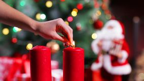 Set Afire of Candles beside a  Christmas tree stock video footage
