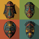 Set of African Ethnic Tribal masks on colour background Royalty Free Stock Photos
