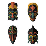 Set of African Ethnic Tribal masks on white background. Flat icons. Ritual symbols Royalty Free Stock Photography