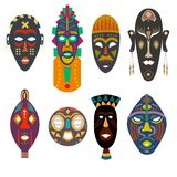 Set of African tribal masks. A set of African masks of different tribes and shapes bright colors under the face with holes vector illustration