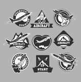 Set of aircraft icons. Set of aircraft and air transportation vector labels.Logo templates,badges,emblems,signs black graphic collection.Air voyage,tour,flight Royalty Free Stock Photography