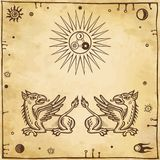Set of alchemical symbols. Mythical dragons protect an alchemical star. Stock Photo