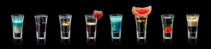 Set of alcoholic cocktails. In shot glasses stock image