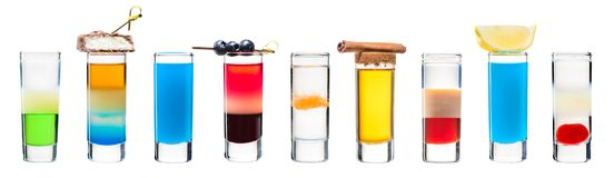 Set of alcoholic cocktails in shot glasses shooters. Isolated on white stock photo