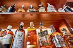 Alcoholic Drinks. Set of alcoholic drinks on their shelves in a restaurant stock photography