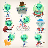 Set of aliens. Colorful little green aliens with huge heads under disguise mastering earth traditions and doing it wrong.  vector cartoons Royalty Free Stock Photo