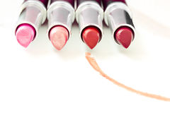 Set of aligned lipsticks with red stroke Stock Images