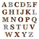 Set of alphabet letters with animal fur patterns. Complete set of colored ornamental uppercase alphabet letters with assorted animal skin or fur patterns in Stock Images