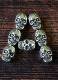 Set alphabet of letters from metal skulls - Halloween Stock Image