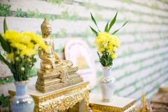 Set of altar table in wedding hall. stage for place the buddha statue for pray and worship before begin the Buddha ceremony. Image for background, objects and Stock Image