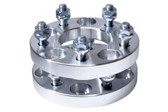 Set of aluminum wheel spacers made by CNC lathe machine. Use to increase the wheelbase and offset ET of the automobile and tunin Royalty Free Stock Photo