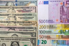 Set of American dollars and set of euros. On desk royalty free stock image