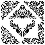 A set of angular ornaments. Ideal for stencil. Ornate tracery of swirls and leaves. Isolated on white background. Decorative vintage style Royalty Free Stock Images