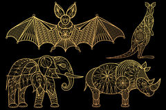 Set of animals elephant, rhinoceros, kangaroo, bat. Animals. Elephant, rhinoceros, kangaroo, bat. Set of vector stylized image. Gold foil print on black Stock Image