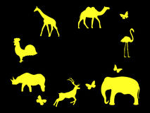 Set of animals. Mammals, birds and insects. Yellow icons on a black background. Vector Royalty Free Stock Images