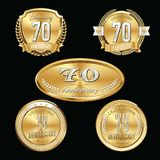 70th Anniversary emblems set. Set of anniversary isolated emblems on black background. 70 golden years with gold ribbons stock illustration