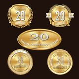 20th Anniversary emblems set. Set of anniversary isolated emblems on black background. 20 golden years with gold ribbons stock illustration