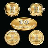 10th Anniversary emblems set. Set of anniversary isolated emblems on black background. 10 golden years with gold ribbons vector illustration