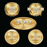 100th Anniversary emblems set. Set of anniversary isolated gold emblems on black background. 100 golden years with gold ribbons stock illustration