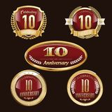 10th Anniversary emblems set. Set of anniversary isolated red emblems on black background. 10 golden years with gold ribbons vector illustration