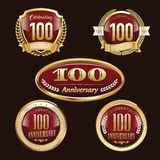 100th Anniversary emblems set. Set of anniversary isolated red emblems on black background. 100 golden years with gold ribbons vector illustration