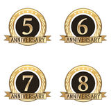 Set Of Anniversary Seals. Set of four gold anniversary seals Royalty Free Stock Photos