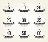 Set of anniversary signs, symbols. Five, ten, twenty, thirty, forty, fifty years jubilee design elements collection. Royalty Free Stock Photo