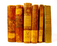 Set of antique books. A set of old, antique books arranged as if on a shelf.  Isolated on a white background Royalty Free Stock Photos