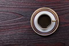 Set of antique cup and saucer decorated and filled with coffee Royalty Free Stock Photos