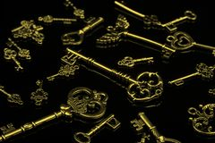 Set of Antique Golden Keys on Black Background Royalty Free Stock Image