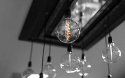Set of antique light bulbs decor glowing light. In black and white background Royalty Free Stock Image