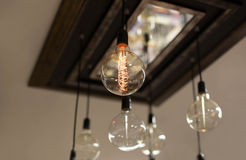 Set of antique light bulbs decor glowing light. On the ceiling Royalty Free Stock Images