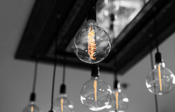 Set of antique light bulbs decor glowing light. On the ceiling Stock Photography