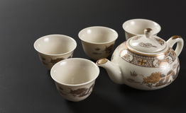 Set of antique teapot and cups Stock Photography