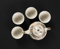 Set of antique teapot and cups Royalty Free Stock Image