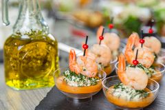 Set of appetizers. Small plates of shrimp salad. Set of appetizers. Small plates of salad with shrimps royalty free stock photo