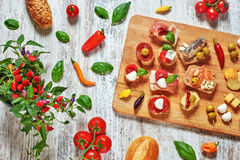 Set of appetizers on a wooden table. Stock Images