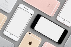 Set of Apple iPhones 6s mockup flat lay top view. Varna, Bulgaria - March 10, 2016: Set of Apple iPhones 6s mockup top view flat lay with white screen and back Royalty Free Stock Photo