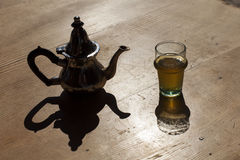 Set of arabic nana mint tea with metal tea. Pot and glasses Stock Images