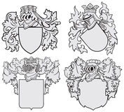 Set of aristocratic emblems No10. Vector image of four medieval coats of arms, executed in woodcut style, isolated on white background. No blends, gradients and Royalty Free Stock Images