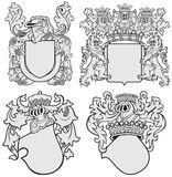 Set of aristocratic emblems No11. Vector image of four medieval coats of arms, executed in woodcut style, isolated on white background. No blends, gradients and Royalty Free Stock Photos