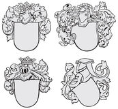 Set of aristocratic emblems No2. Vector image of four medieval coats of arms, executed in woodcut style, isolated on white background. No blends, gradients and Royalty Free Stock Images