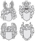 Set of aristocratic emblems No3. Vector image of four medieval coats of arms, executed in woodcut style, isolated on white background. No blends, gradients and Stock Image