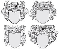 Set of aristocratic emblems No5. Vector image of four medieval coats of arms, executed in woodcut style, isolated on white background. No blends, gradients and Royalty Free Stock Photos