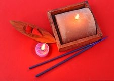 Set of aromas on red background. Set of aromas with candles and wooden support on red Royalty Free Stock Images