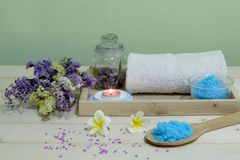 Set aromatherapy spa and candle with flowers on wooden table. stock images