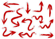 Set of arrows painted rough brush by hand. Tough red strokes. 12. Elements  on white background. Abstract Stock Image