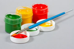 Set of art gouache paints and brush Stock Photo